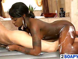 Dark gal gives soapy massage to favourable white client HD Porn Vids