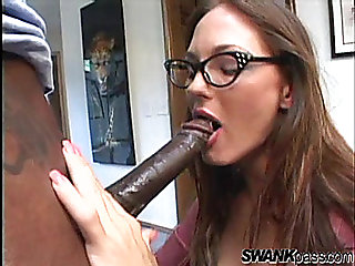 Naughty broad with glasses receives double penetration from 2 dark studs