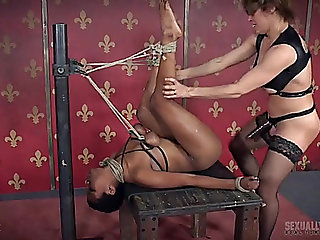 Rope tied milk sacks hurt as that guy copulates the dark babe