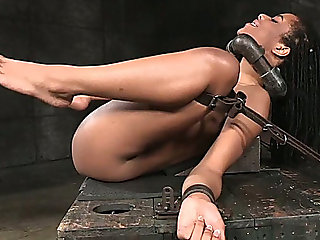 Sexy dark hotty restrained on the table and drilled hard