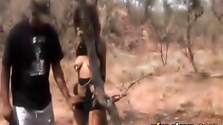 African slave gets abused by two studs outdoors