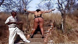 Chubby ebony sex slave gets tied and spanked by her master in some hardcore outdoor abuse