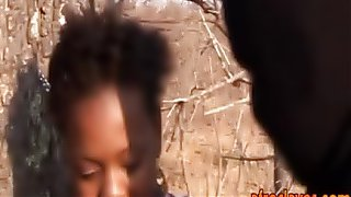 Afro slave whipped and banged by masters outdoors