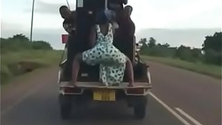 Sexy African babe shaking her ass on the moving car